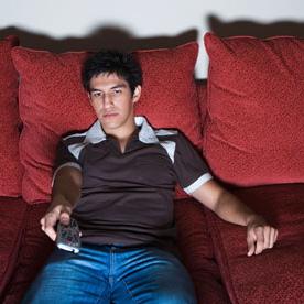 Man-on-sofa-watching-TV--010